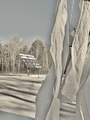 Solar panels and drying laundry in snowy yard photography by AgathaO