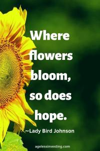 "A Sunflower against a green background, quote ""Where flowers bloom, so does hope."" -Lady Bird Johnson"