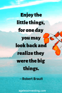 """A picture of a tree branch with orange leave with blue water and a mountain in the background. quote """"Enjoy the little things, for one day you may look back and realize they were the big things."""" Robert Brault, agelessinvesting"""