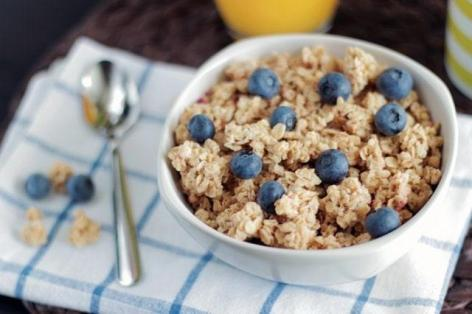 A bowl of oatmeal with blueberries