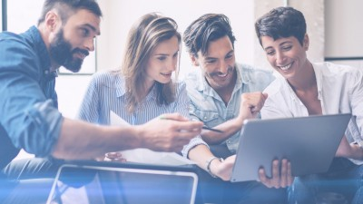 Teamwork process.Young entrepreneur work with new startup project in office.Woman holding touch pad in hands,bearded man pointing to screen.Horizontal, blurred, flare
