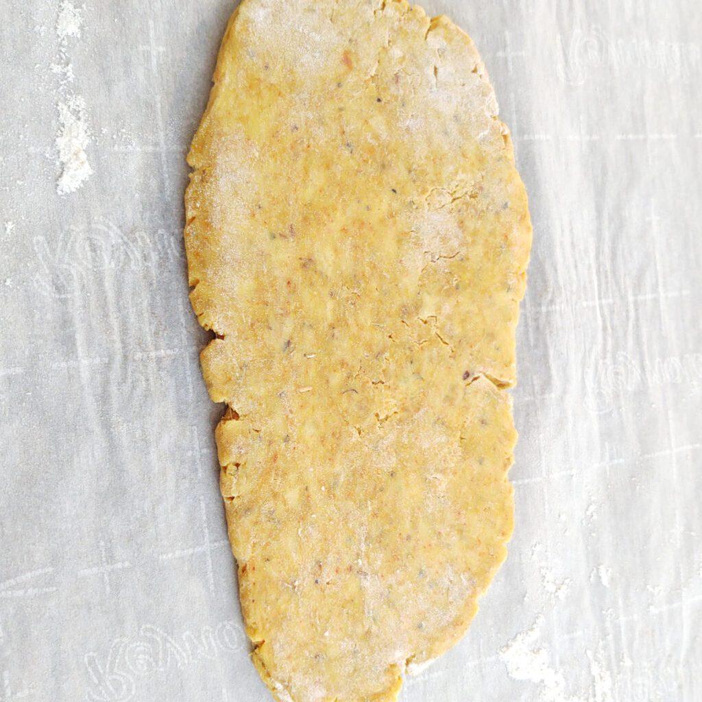 Flattening cracker dough