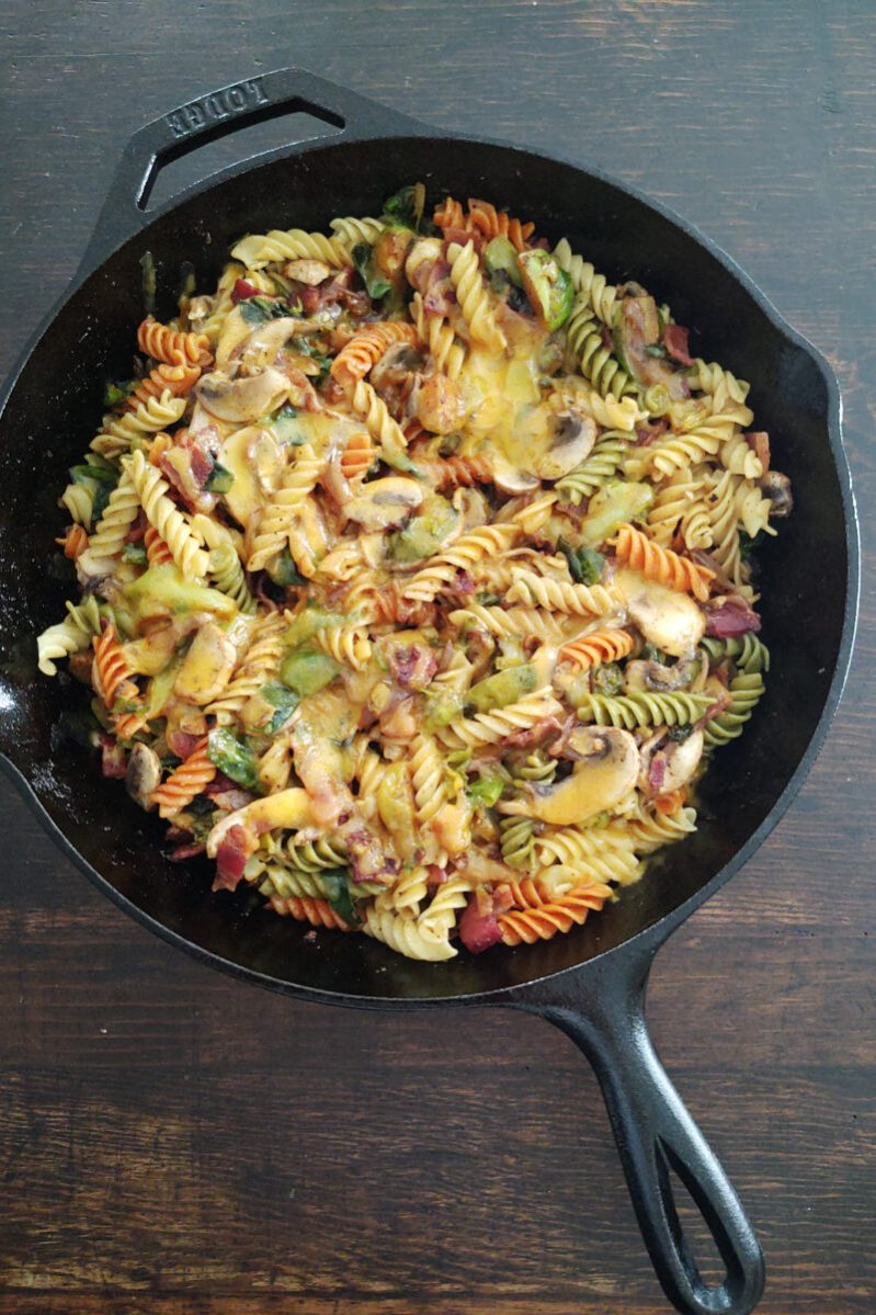 Cheesy Brussels Sprouts Carbonara with Bacon and Mushrooms in Cast Iron