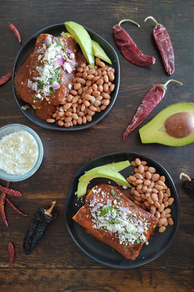 dual plated chicken chayote red enchiladas with avocado and beans