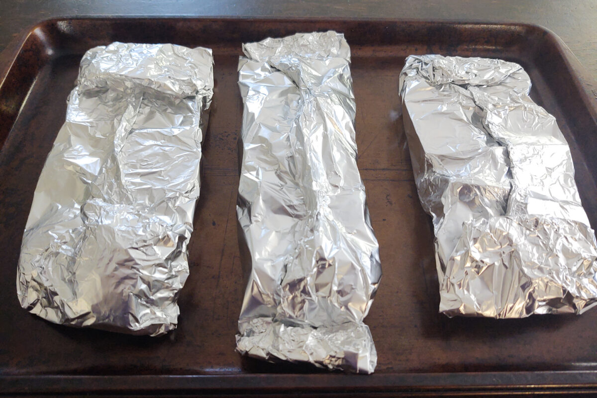 Beets and carrots wrapped in foil with seam facing up