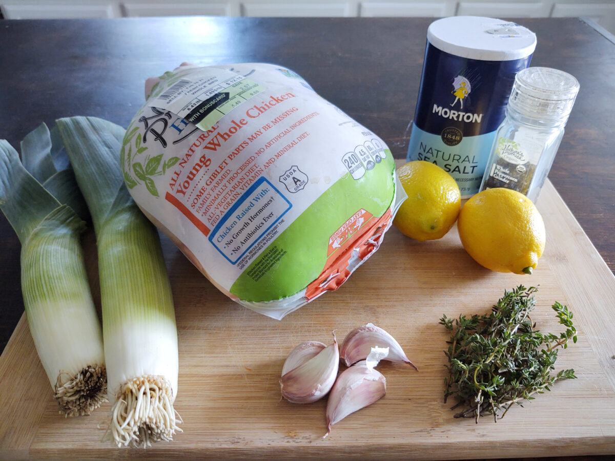 Ingredients on a cutting board to make a chicken roast