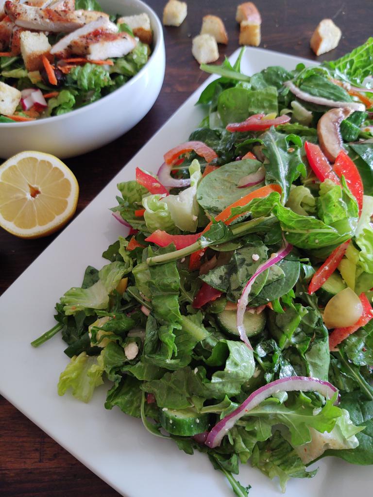 Vertical shot of mixed green garden salad