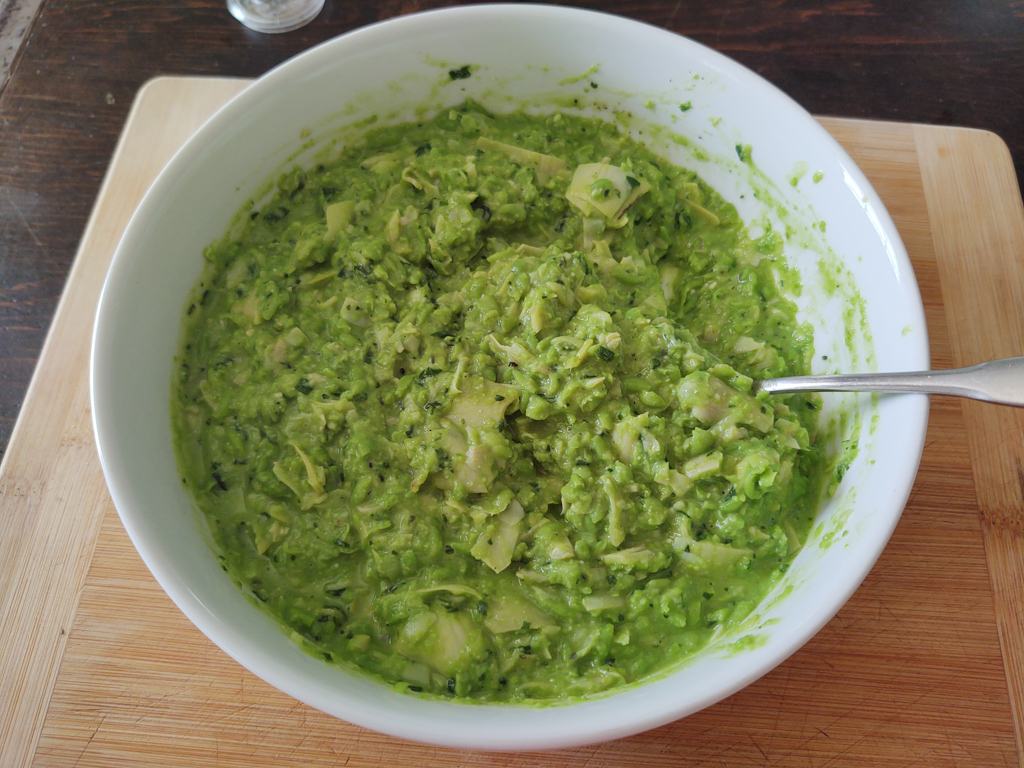 pea pesto in a white bowl