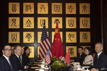 Chinese Vice Premier Liu He, right, sits with U.S. Trade Representative Robert Lighthizer, second from left, and Treasury Secretary Steven Mnuchin, left, before the start of talks at the Xijiao Conference Center in Shanghai, July 31, 2019.