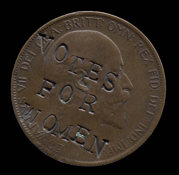 a photo of a penny with kings head and the imprinted words Votes for Women