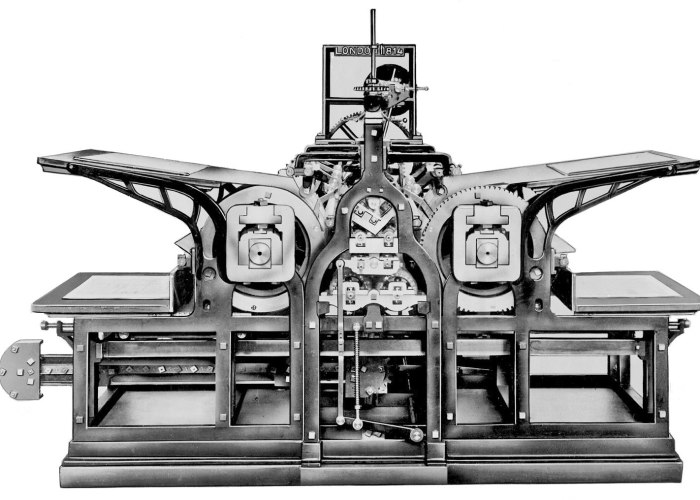 A black and white image of an early printing machine.