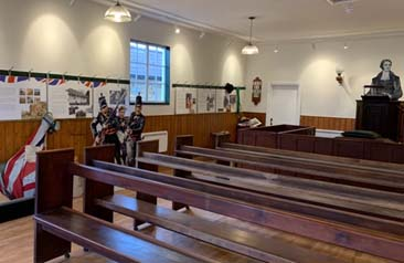 a photo of an interior with pews and pulpit