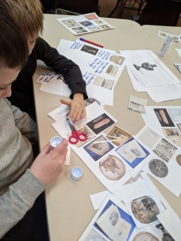 students making collages with images around the abolition of slavery
