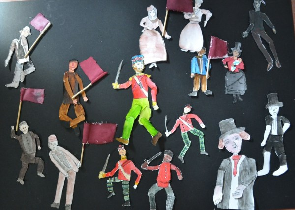 a group of paper puppets