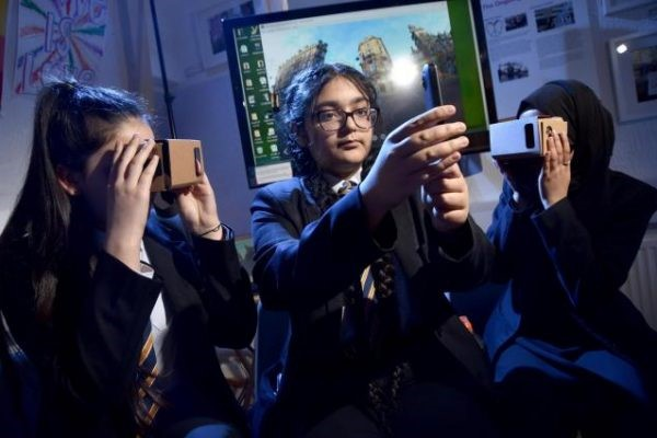 three girls with cardboard VR devices