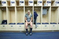 Taryn Rose listens to music in the personalized soccer room as she prepares for a game.