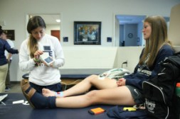 Trainer Kristen Bartiss (left) and Natalie Stoven in the athletic training room.