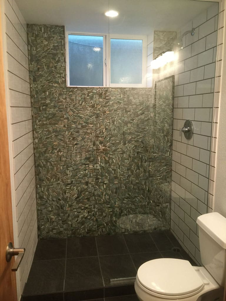 River stone and ceramic subway tile shower.