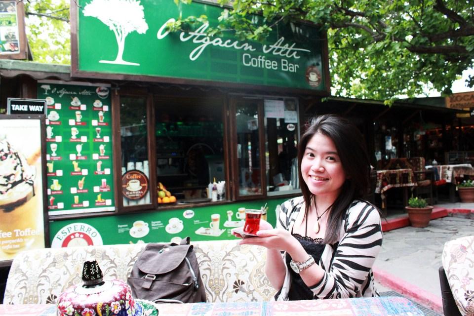 female solo traveller with turkish apple tea