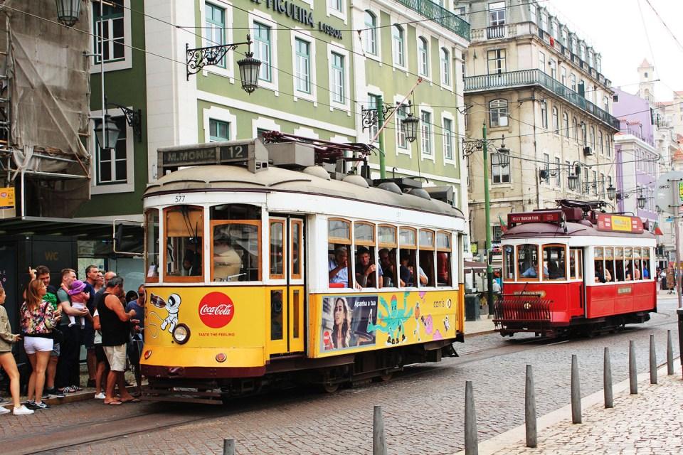 lisbon yellow red tram low maintenance travel