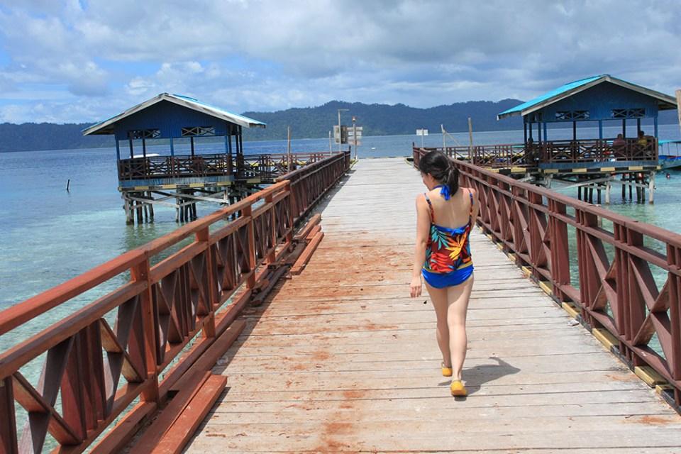 girl walking on a bridge beach digital detox trip