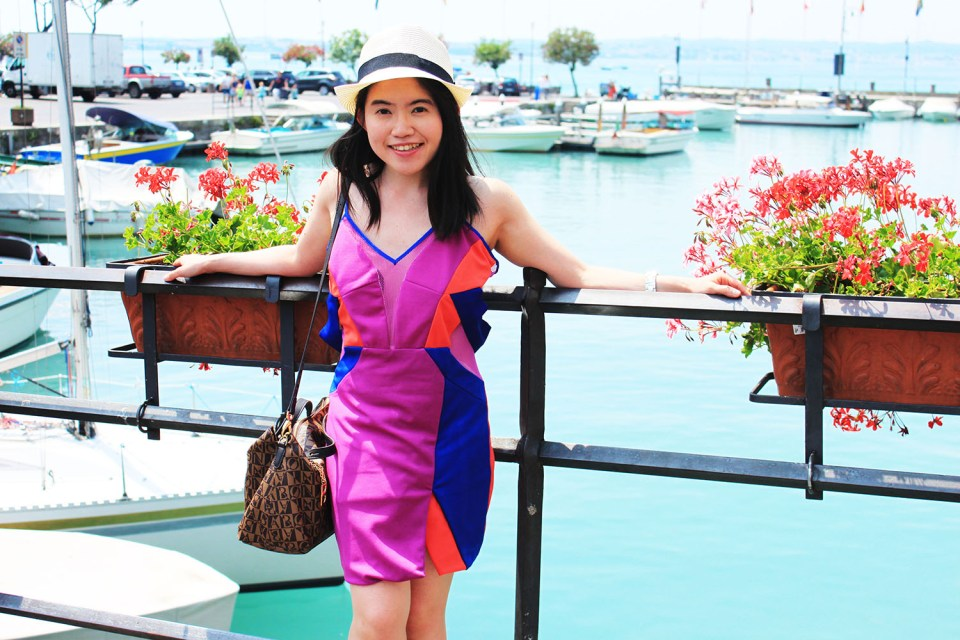 low maintenance girl in pink dress travelling italy