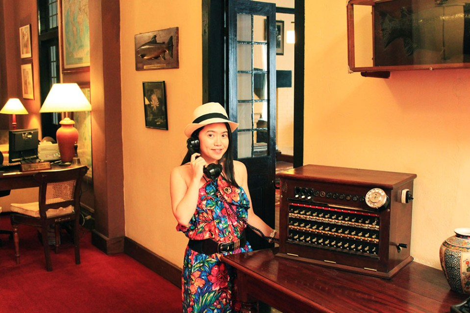 girl with vintage english telephone at the hill club nuwara eliya sri lanka