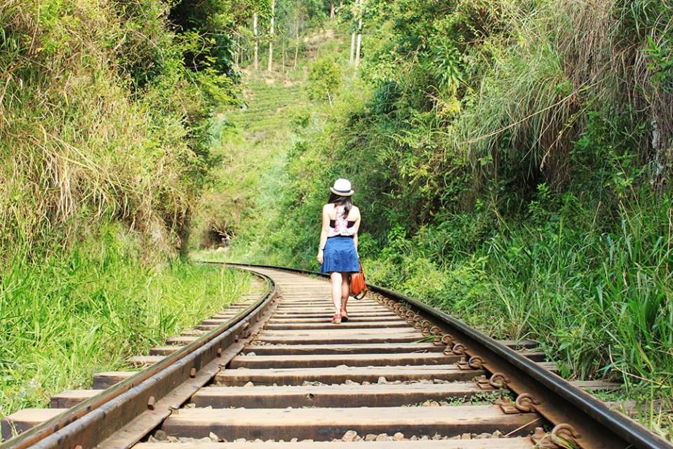 vintage female traveler on the train track sri lanka lonely planet hottest destination 2019
