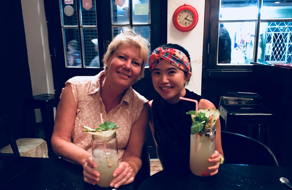 european and asian tourist enjoying mojito in o'riley havana cuba