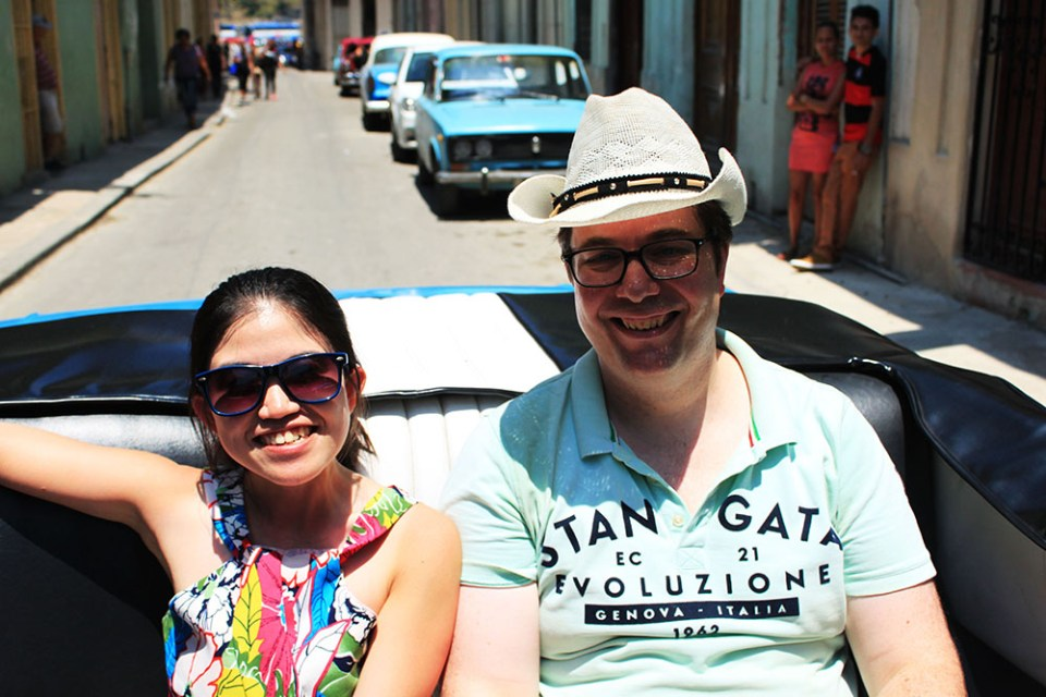 travellers posing in the vintage car havana cuba ride