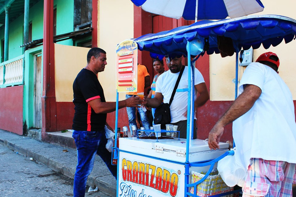 people queueing for street food in cuba havana street