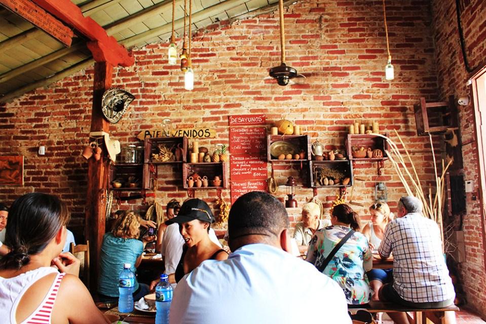 travellers flocking at Meson La Cuchipapa, a food survival guide in Cuba