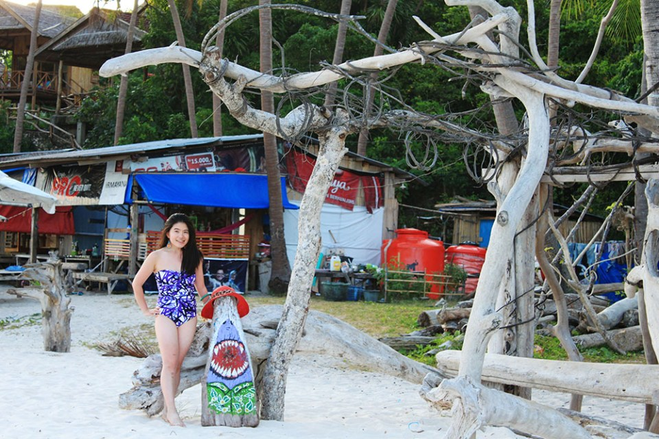 a girl in purple Jasper Conran swimsuit posing in Tanjung Bira beach holiday near BaraCoco Bungalows