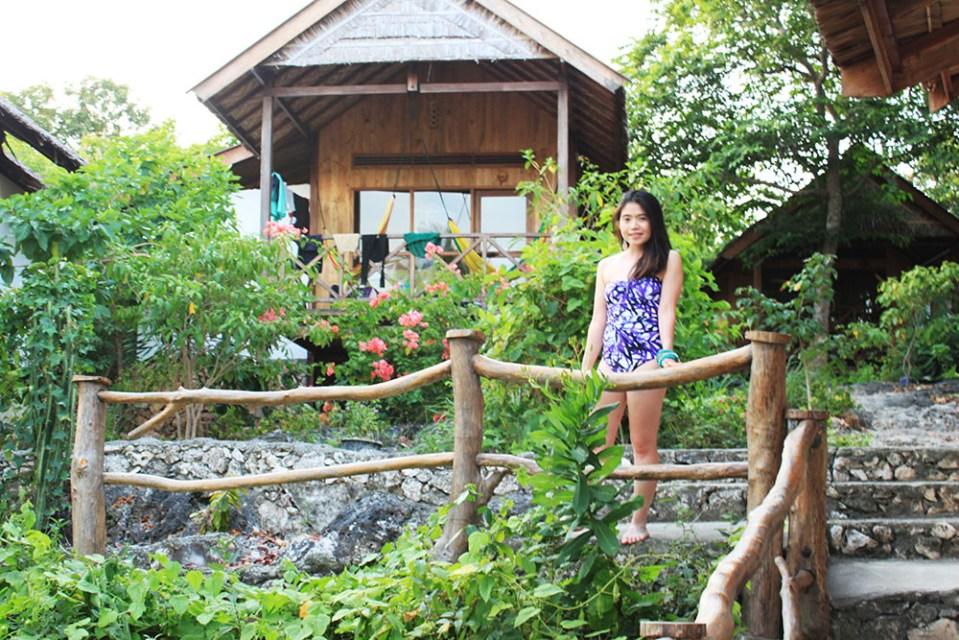 a girl in Jasper Conran swimsuit posing at BaraCoco Bungalows Tanjung Bira Indonesia