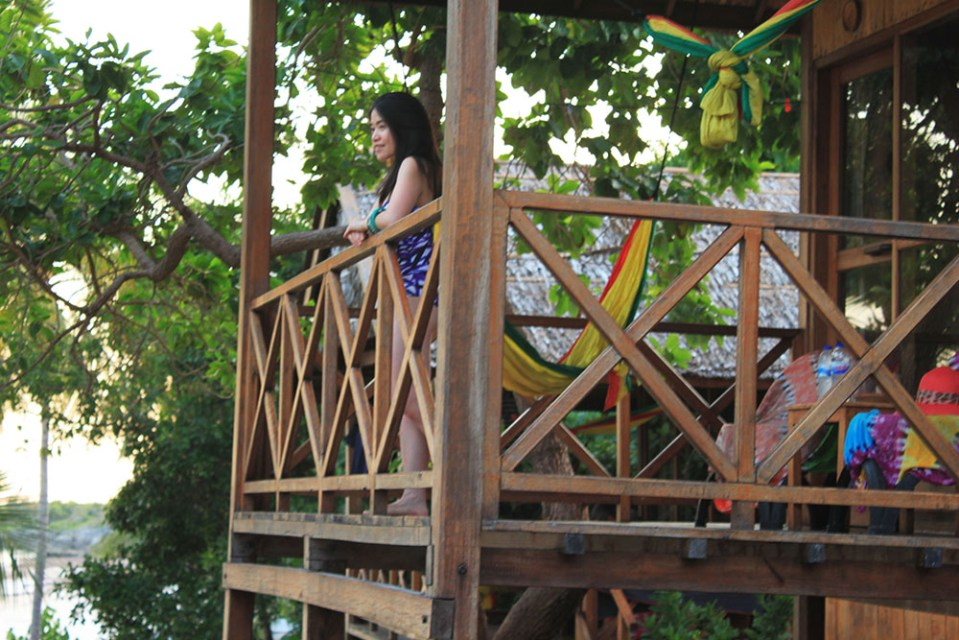 a girl enjoying the beach view from BaraCoco Bungalows Sulawesi Indonesia