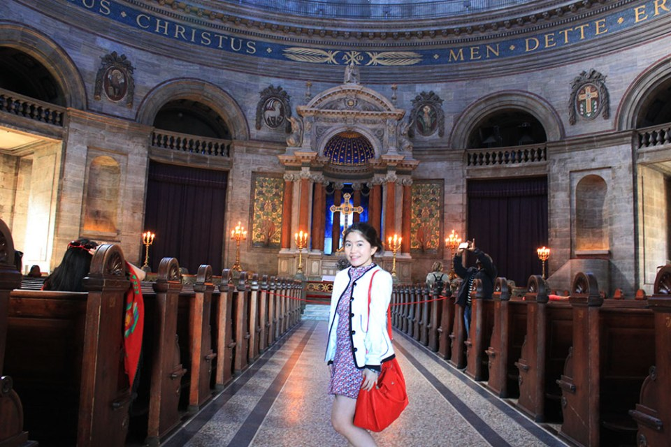 A girl posing in a church in Copenhagen during her digital detox trip in the city