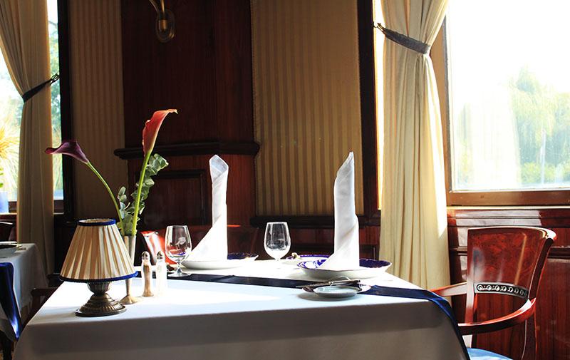 Gundel restaurant Budapest morning breakfast empty table chair window sunshine