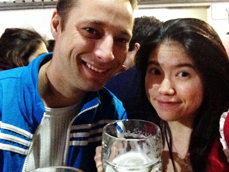 european man asian girl drink beer oktoberfest luna park at night munich germany