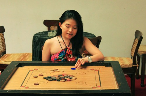a girl playing board game joy of missing out travel lesson art of not giving a f*ck