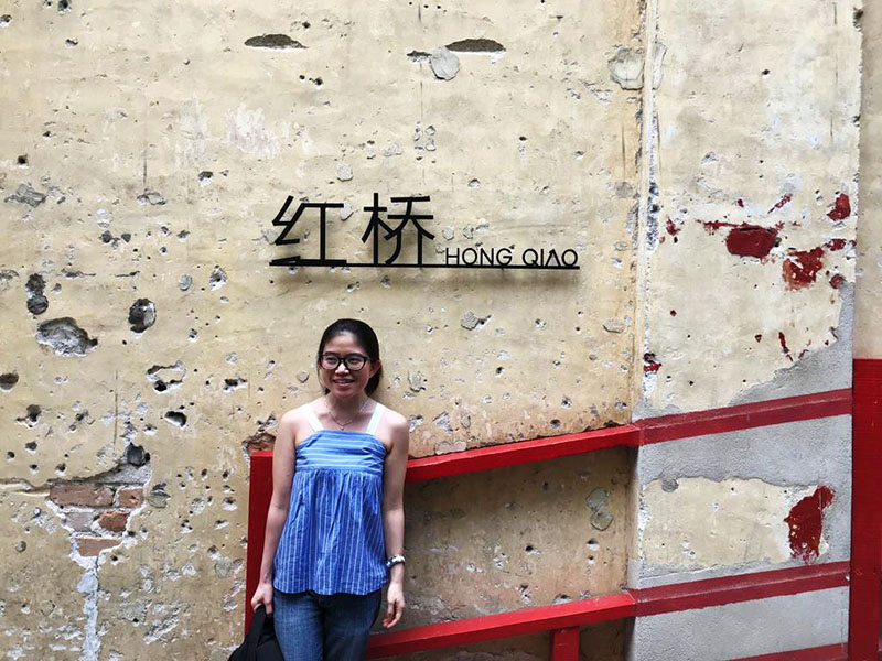 agirlnamedclara asian girl with specs smiling at hong qiao bridge lorong panggung chinatown kl