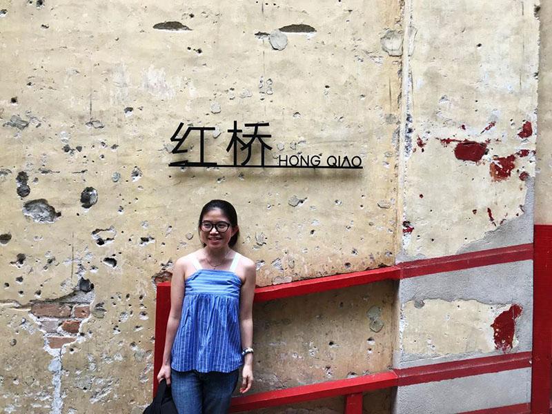 agirlnamedclara asian girl with specs smiling at hong qiao bridge lorong panggung chinatown kl