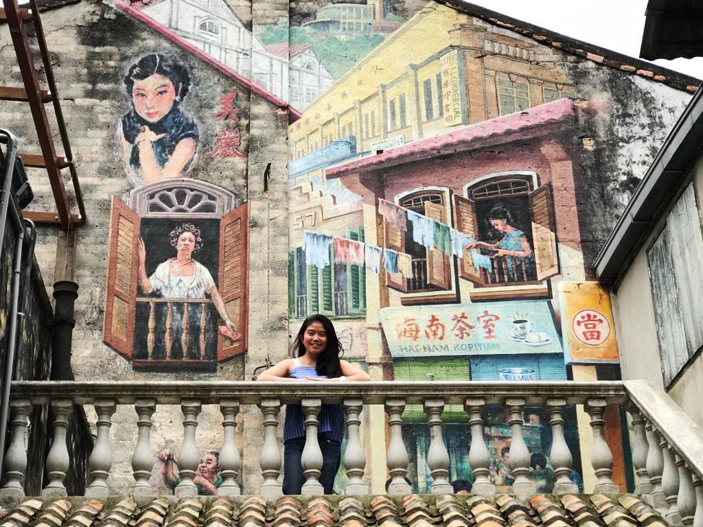 asian girl long black hair smile chinatown kl lorong panggung vintage decor rooftop mural painting