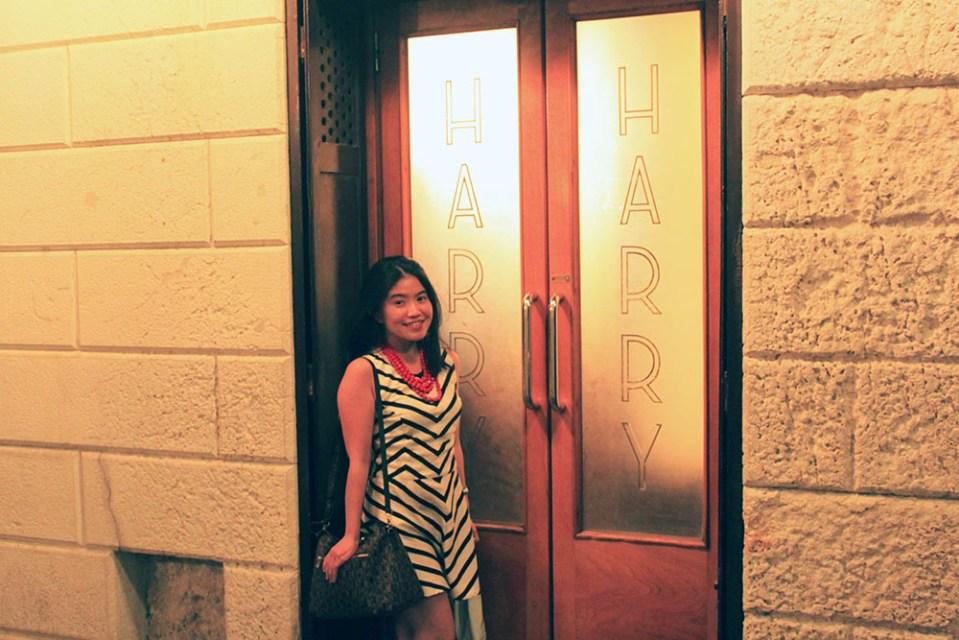 asian girl traveler tourist in front of Harry's Bar entrance venice italy