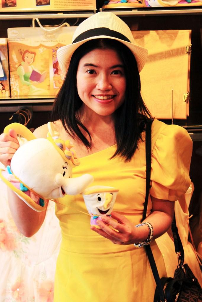 asian girl solo traveller yellow dress belle costume disney shop venice mrs potts toy_agirlnamedclara