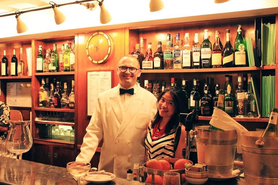 harrys bar venice italy asian girl solo traveler tourist bartender pose for photo_agirlnamedclara
