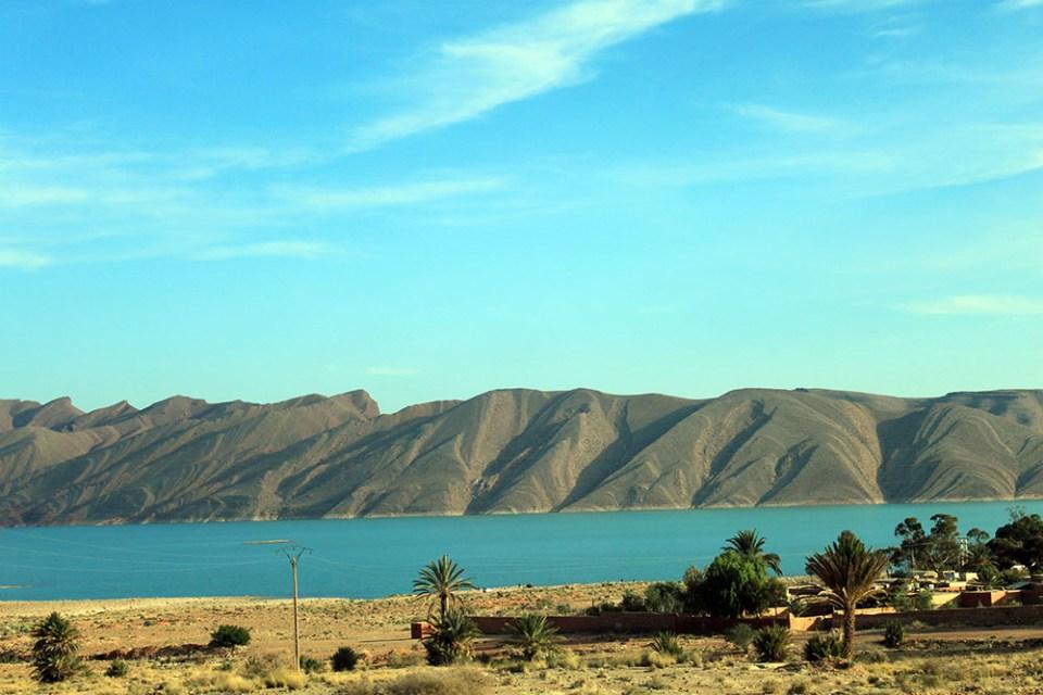 morocco mountains river palm tree blue sky background sunny agirlnamedclara