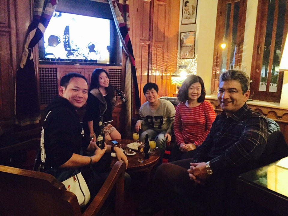 chinese tour group tourist morocco tour guide sitting in rick's cafe casablanca drinking beer watching movie agirlnamedclara