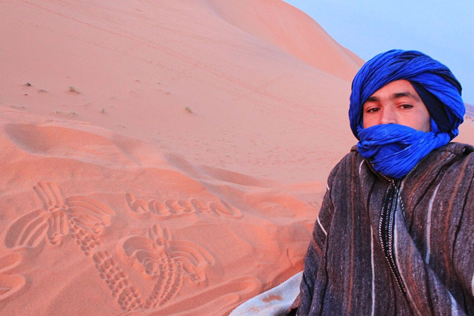 sahara desert morocco local guide in blue head scarf sunrise agirlnamedclara