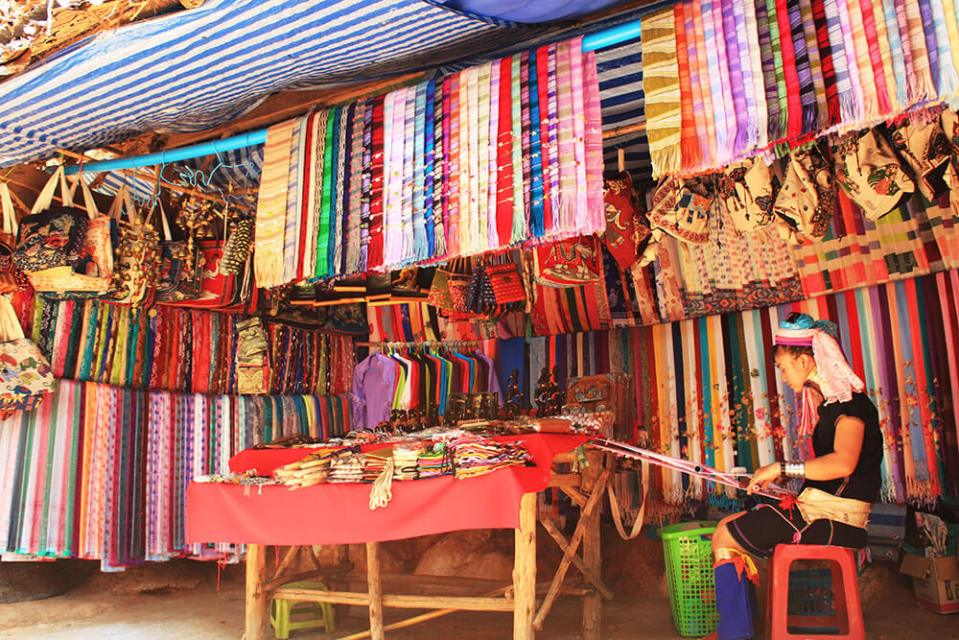 long neck woman sewing colourful textile long neck tribe village chiang mai agirlnamedclara