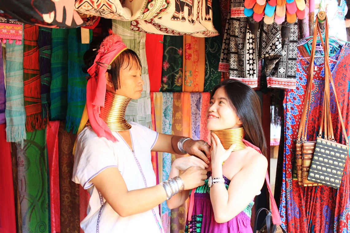asian girl traveler tourist trying golden necklace long neck tribe village chiang mai agirlnamedclara